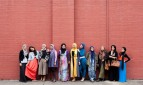 Group of women, some wearing hijabs, photographed for Faith, Fashion, Fusion exhibition on Islamic Australian women's dress.