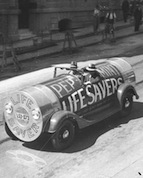 "A sales promotion car done up as a packet of peppermint ""Lifesavers"", Sydney, photo by Samuel Hood, image courtesy State Library of NSW."
