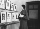 Woman viewing works of art at Art Gallery