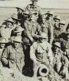 Australians pose for their photograph on a captured German gun, image courtesy of the SLNSW