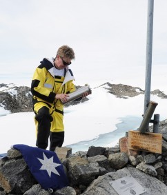 Australian Antarctic Division Director Tony Fleming places the time capsule at Proclamation Hill above Mawson's Hut as they celebrate the 100th anniversary of Mawson's Landing at Commonwealth Bay in Antarctica, Monday, Jan. 16, 2012. The time capsule contains a message from Prime Minister Julia Gillard and messages from selected school children. (AAP Image/Dean Lewins)