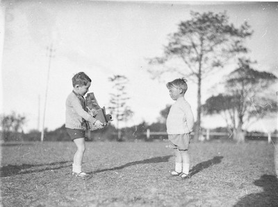 One little boy taking a photo of another with a newspaperman's Graflex camera, Dalwood Home, 1929, by Sam Hood, courtesy State Library of NSW